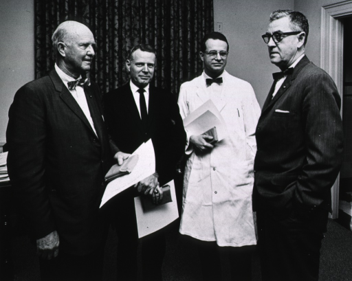 <p>Showing Dr. James Shannon, Dr. Robert Chanock, Dr. John Sherman, and another unidentified person meeting after an awards ceremony.</p>