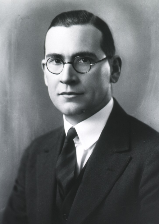<p>Head and shoulders, full face, facing left, glasses.</p>