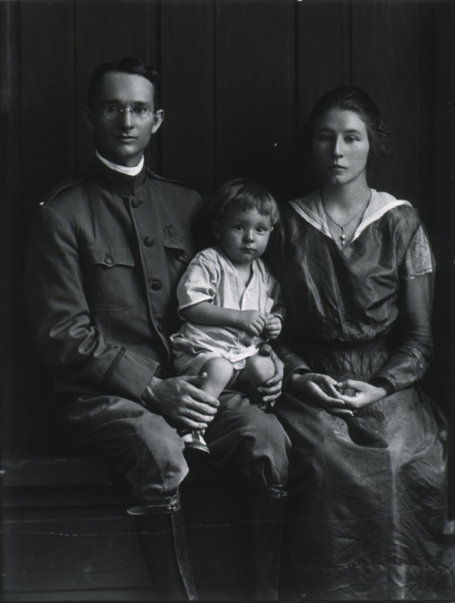 <p>Full length, seated, full face; wearing uniform; with child sitting on his lap, and his wife to the right.</p>