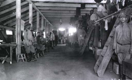 <p>An interior view of personnel in their sod barracks.</p>
