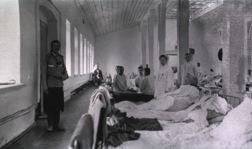 <p>Patients, medical personnel and a nurse in a ward in the St. George No. 1 Red Cross Hospital.</p>
