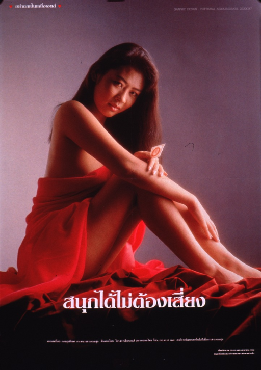 <p>Multicolor poster with white lettering.  Most lettering in Thai script.  Visual image is a color photo reproduction featuring a young woman holding a condom.  The woman is seated and draped in red fabric, exposing one shoulder and her legs.  Most text at bottom of poster.</p>