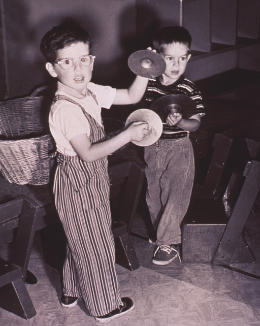 <p>Children playing with musical instruments.</p>