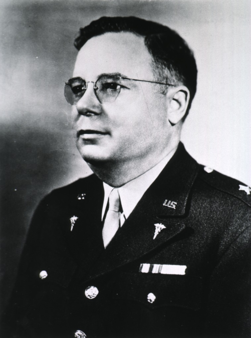 <p>Head and shoulders, left pose; wearing uniform and glasses.</p>