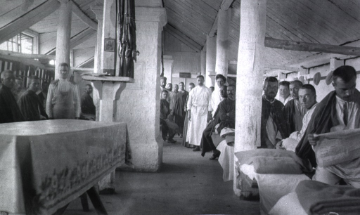<p>Patients and staff in a ward at Military Mobile Hospital No. 75.</p>