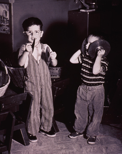 <p>children are playing with musical instruments.</p>
