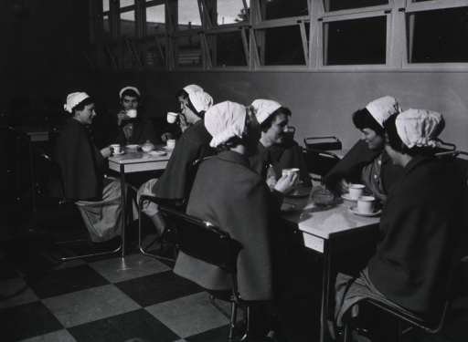 <p>Students seated at tables in cafeteria.</p>