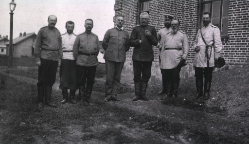 <p>Chief Medical Inspector Garbatsumtch and members of his staff stand outside a building (hospital?).</p>