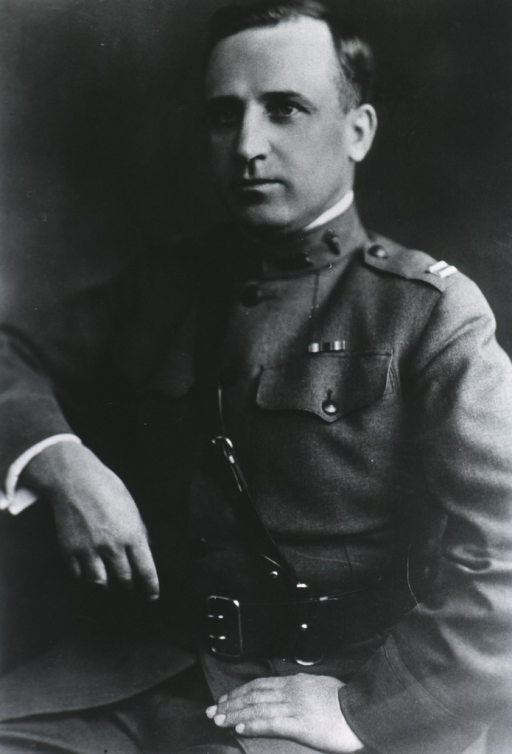 <p>Half-length, seated, left pose; wearing uniform; arm resting on back of chair.</p>