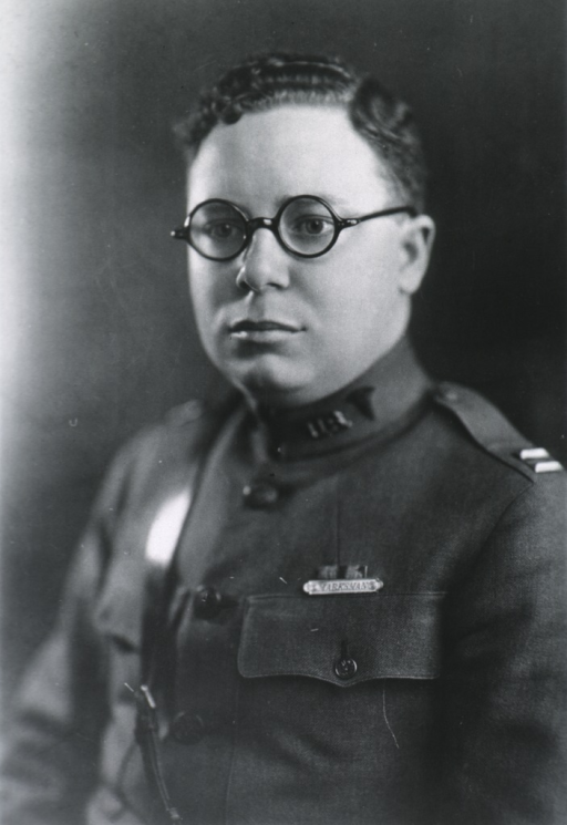 <p>Head and shoulders, left pose, full face; wearing uniform and glassses.</p>