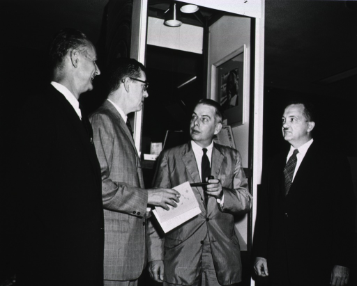 <p>Dr. James A. Shannon and Dr. T.F. Hilbish chat with Frederick G. Kilgour of the Yale Medical Library, and Frank B. Rogers, Director of the National Library of Medicine.</p>