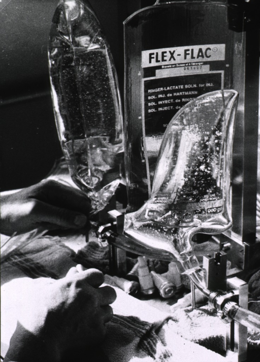 <p>A 'Flex-Flac' being filled with a rehydration solution and a full package is about to be sealed.</p>