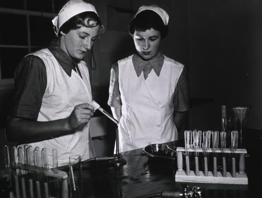<p>Two students in laboratory.</p>