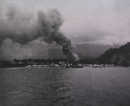 <p>View of smoke over the town from the harbor.</p>