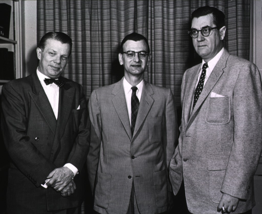 <p>Dr. James A. Shannon and Dr. Floyd Daft, Director NIAMD, welcome Dr. William D. Robinson, President of the American Rheumatism Association, at the Third Interim Scientific Session, held at the Clinical Center on Nov. 30, 1956.</p>