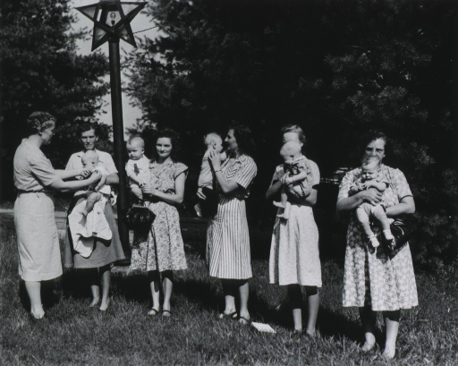 <p>Rosa Clark immunizing babies during the 1947 Baby Round-up.</p>