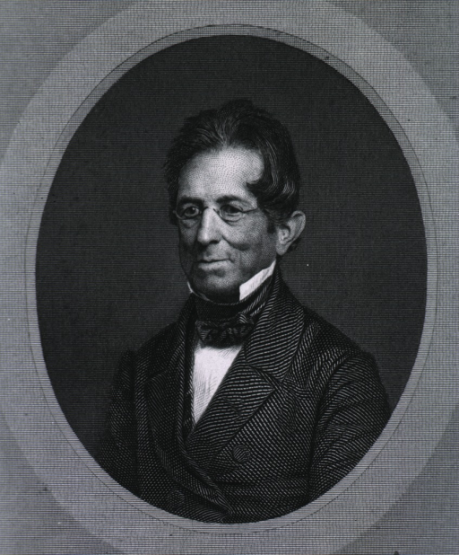 <p>Head and shoulders, left pose, full face, wearing glasses; in oval.</p>