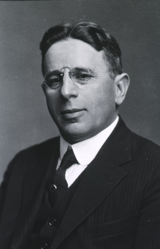 <p>Head and shoulders, left pose, full face; wearing glasses.</p>