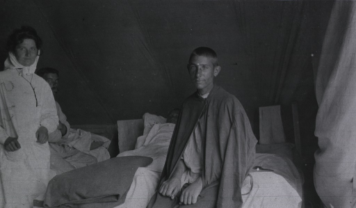 <p>A nurse and three patients in their tent at Military Mobile Hospital No. 75.</p>