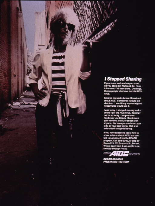 <p>The poster shows a woman in jeans, shirt, and jacket, leaning against a brick wall in an alley. The text on the poster stresses the importance of not sharing drug paraphernalia and how doing so can lead to the contraction of  AIDS.</p>