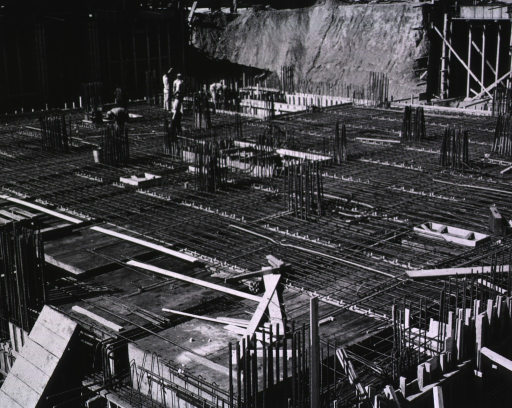<p>Showing the network of steel reinforcing rods used in the construction of the walls and floors in the excavated area.</p>