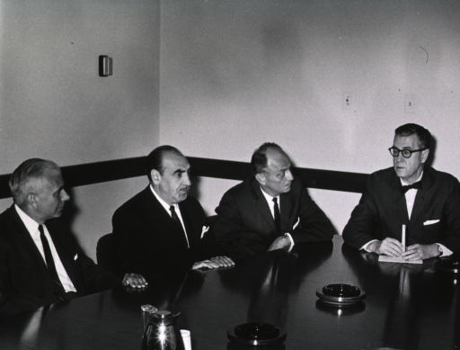 <p>Showing seated around a conference table are Anthony Celebrezze, Dr. James Shannon, Surgeon General Luther Terry, and Mr. Boisfeuillet Jones.</p>