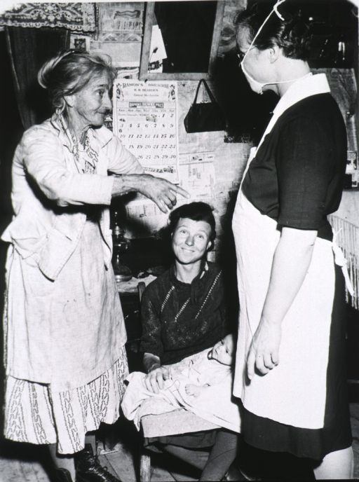 <p>Clark instructs another nurse in home health care for a mother and her infant.</p>