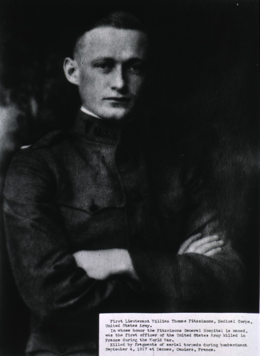 <p>Seated, wearing uniform, hands folded.</p>