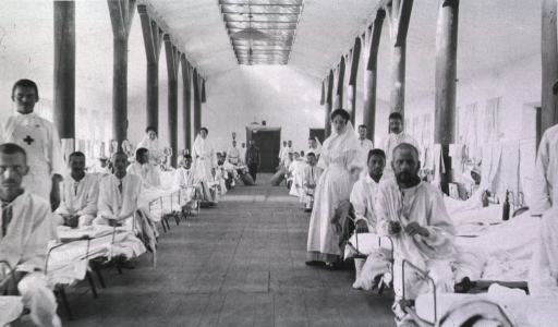 <p>Patients, nurses and medical personnel in a ward at St. George No. 2 Red Cross Hospital.</p>