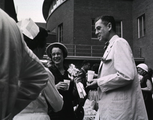<p>Showing Dr. James Shannon and his wife outside the Clinical Center during the dedication ceremonies for the Surgical Wing and Blood Bank.</p>