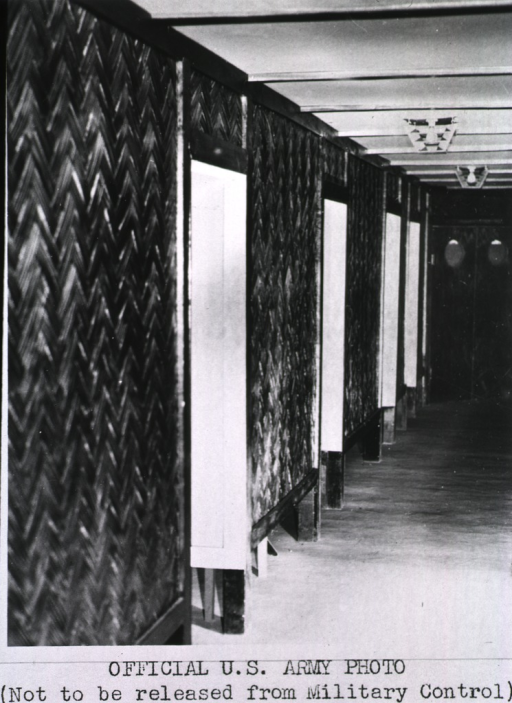 <p>View of a hallway leading to double-doors.</p>