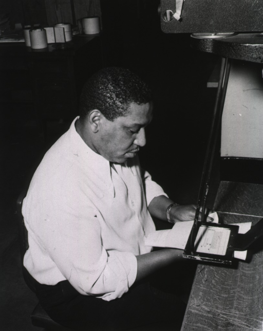 <p>Interior view: Acquisition Division.  Mr. Jordan photographing with a Kodak Recordak.</p>