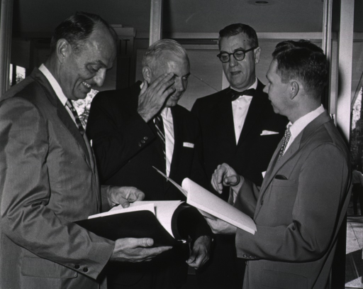 <p>Dr. James A. Shannon, Surgeon General Luther Terry, and Boisfeuillet Jones are briefed by NIH Information Officer, Clifford Johnson, on plans for the dedication ceremonies.</p>