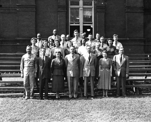 <p>Major Frank B. Rogers, front row and center, stands with the Army Medical Library's Office of the Director and Administrative Division. Front Row: M/Sgt. Albert S. Stricker, Sam W. Roberts, Ethel M. Chase, Major Frank B. Rogers, Scott Adams, Alice E. Luethy, Joseph Tucker. 2nd Row: Mary I. Henke, Martha S. Dietrich, Dorothy J. Simken, Ruth G. Strom, Lee E. Dean, Aldine D. Mudd, Mary M. Koehler. 3rd Row: Raymond J. Campbell, Sarah C. Jenifer, Cpl. Leonard K. Bikowski, Pfc. Gene Sensing, Sgt. 1 cl Alvin P. Eagle, M/Sgt. Stephen S. Bartkus, Cpl. George Steffa. 4th Row: Enas Broadway, Herbert C. Smith, Richard F. Clanton, Norris A.G. Scott.</p>