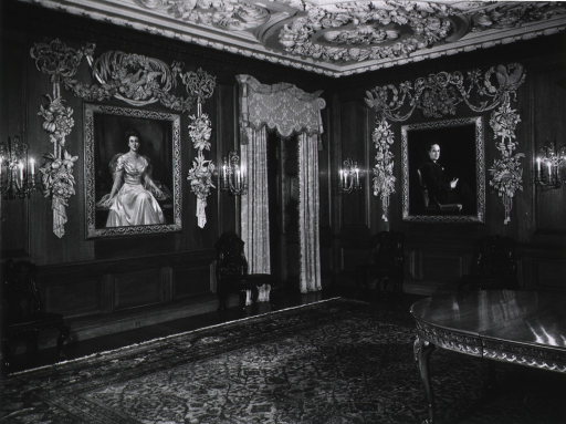 <p>Interior view of the Whitehead Memorial Room in the Conkey Pate Whitehead Memorial Surgical Pavilion. Portraits are of Conkey Pate Whitehead and his mother, Mrs. Lettie Pate Evans; the room features oak paneled walls and ornamental plaster ceiling.</p>