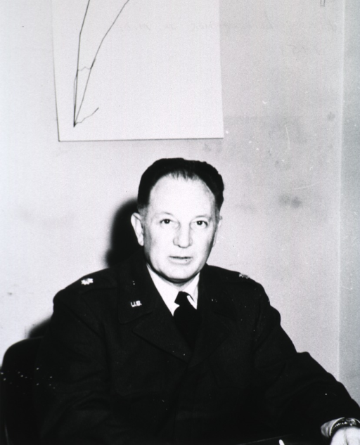 <p>Half-length, seated, full face; wearing uniform.</p>