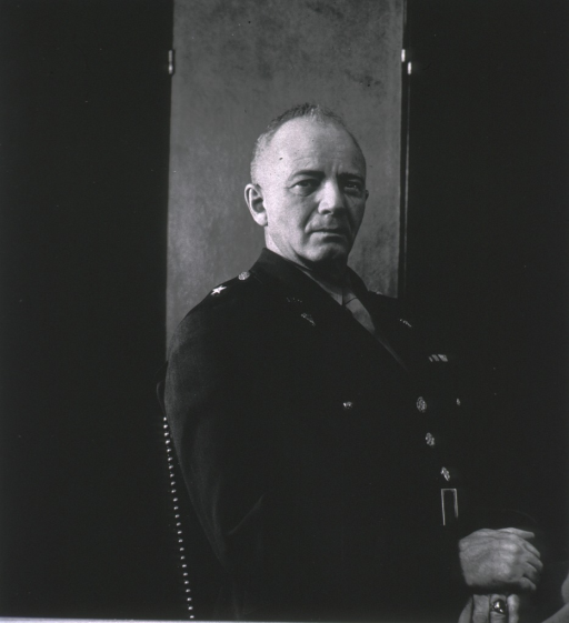 <p>Seated, full face, hands crossed in front, wearing uniform (brigadier general).</p>