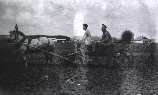 <p>The Commanding Surgeon being chauffeured in a cart through the mud at Military Mobile Hospital No. 75.</p>