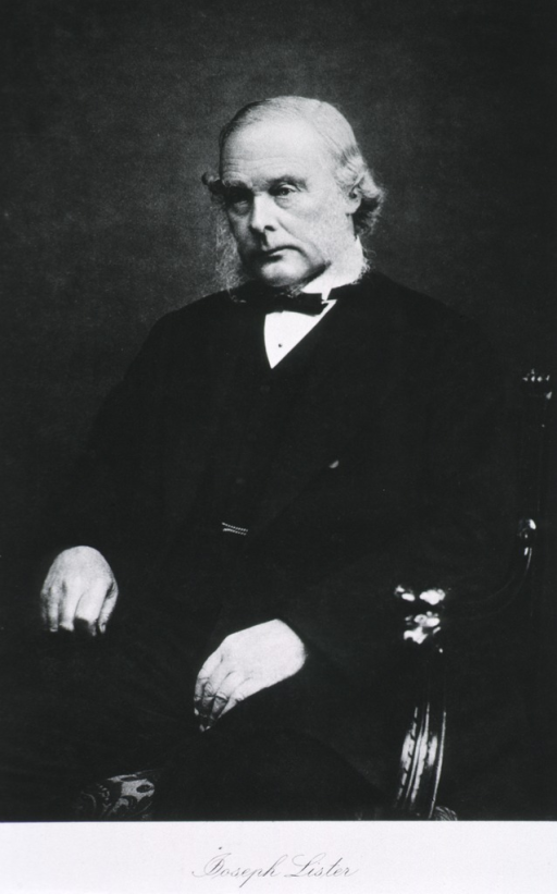 <p>Three-quarter length, seated, left pose, arms on chair.</p>