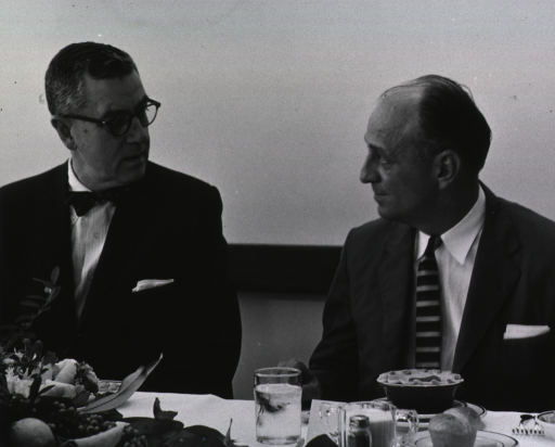 <p>Showing Dr. James Shannon conferring with Surgeon General Luther Terry at the dedication ceremony luncheon for Building 31.</p>