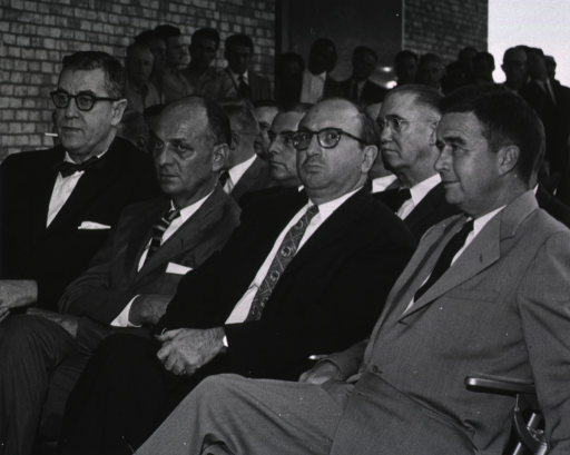 <p>Dr. James Shannon sits with honored guests at the dedication ceremony for Building 31.  Seated next to Dr. Shannon are Surgeon General Luther Terry, Mr. Wilbur J. Cohen, and Dr. James V. Lowry.</p>