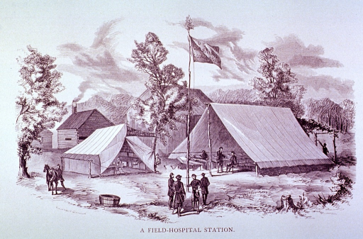 <p>Exterior view:  Showing tents used as wards and operating rooms during Civil War era; flagpole and soldiers in foreground.</p>