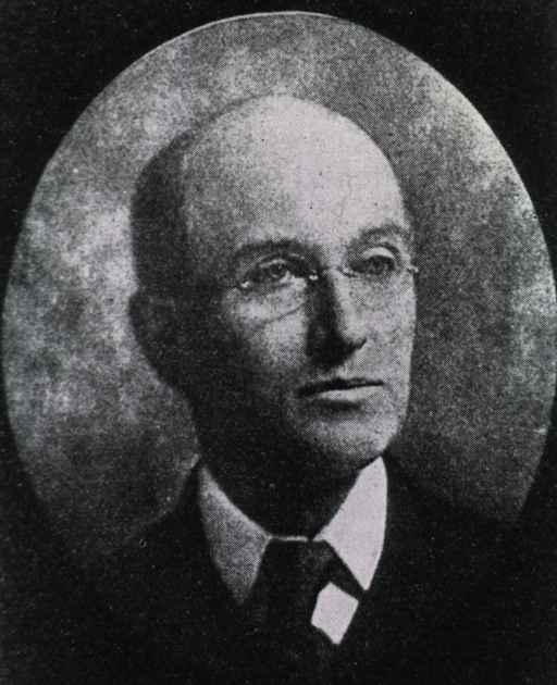 <p>Head and shoulders, with glasses, looking right; in oval frame.</p>