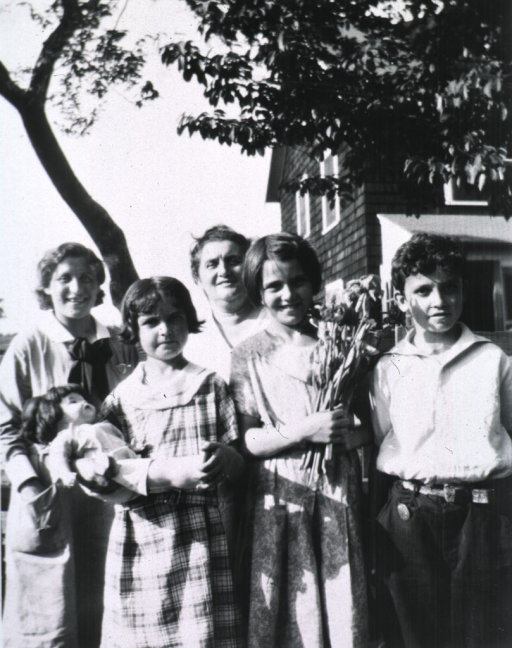 <p>Exterior view showing the three children with Mrs. Thomas and Miss Kramer.</p>