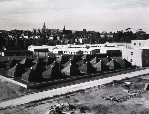 <p>Three rows of tents are pitched next to tennis courts on the grounds of the 4th General Hospital.</p>