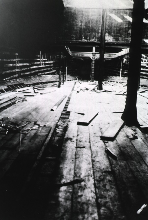 <p>View of ship's interior with floor boards pulled up and scattered in preparation for fumigation during visit to Quarantine Station, New York Harbor, by League of Nations fumigation experts.</p>