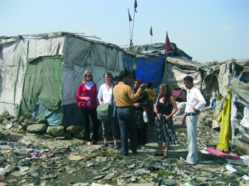 Sandra de Castro Buffington (first on left) and colleagues on a story tour of a Mumbai slum in India.