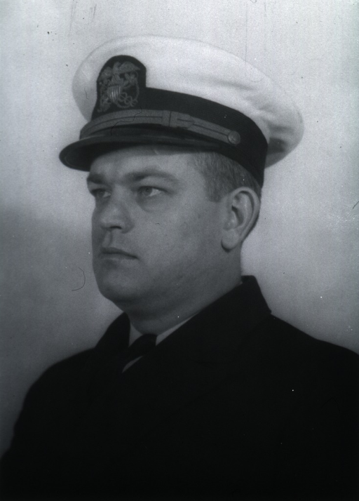 <p>Head and shoulders, full face, head to left, wearing white cap with USPHS insignia.</p>