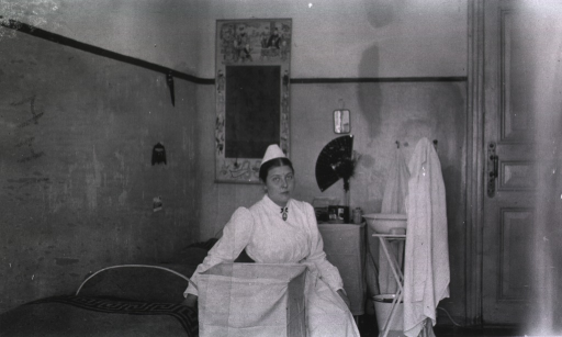 <p>A nurse sits in her room at a German Red Cross Hospital.</p>