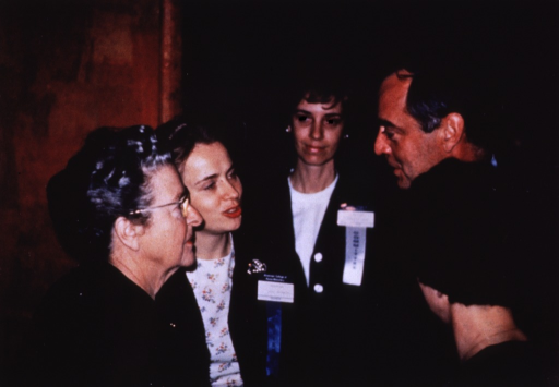 <p>Corbin and four other people gather at a conference.</p>